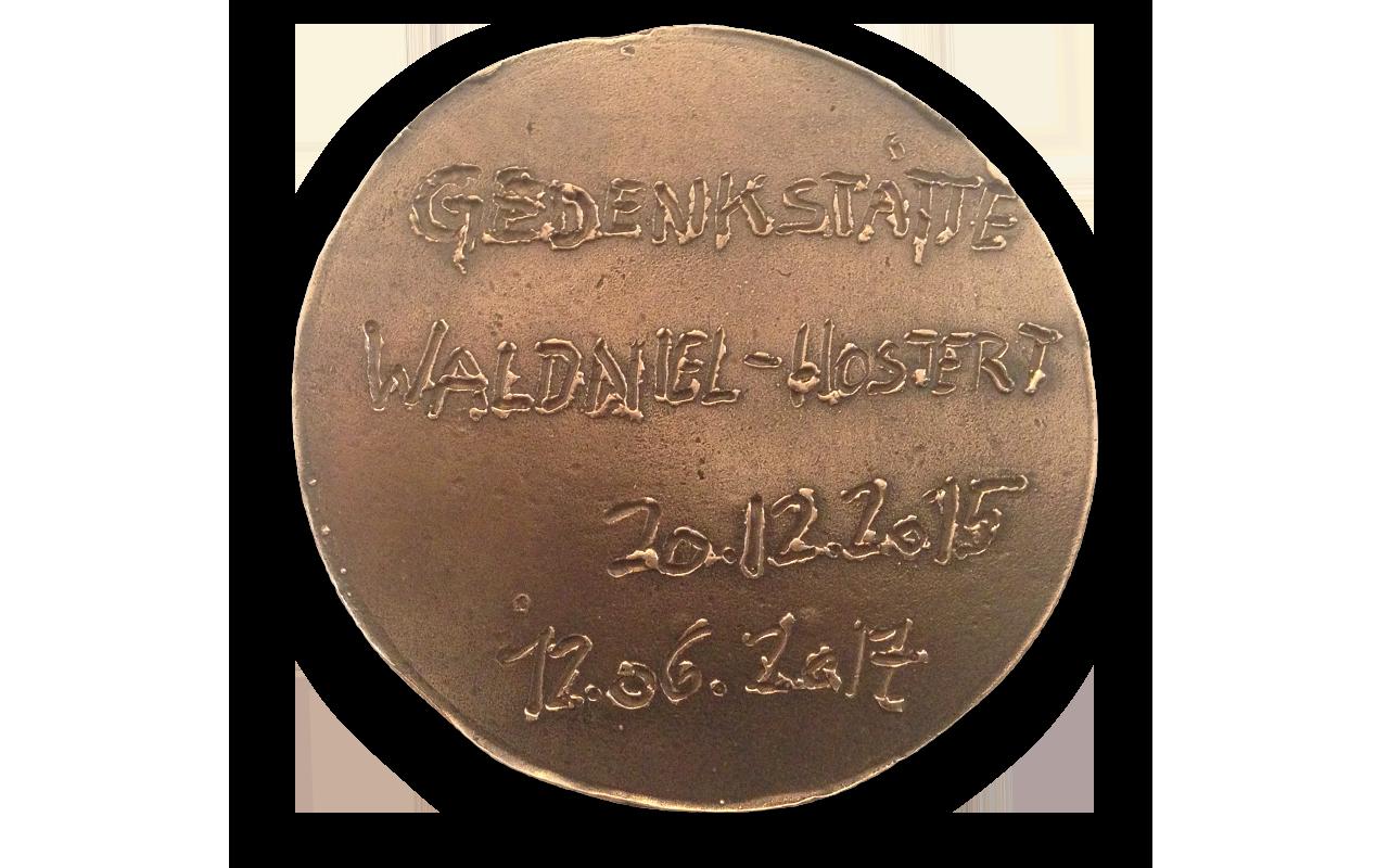 Probeguss einer Bronzeplakette